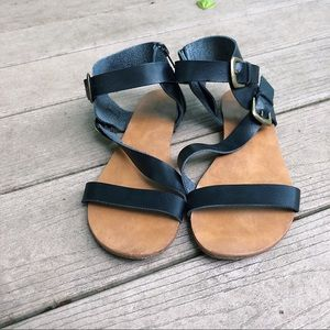 Black strappy black buckle sandals